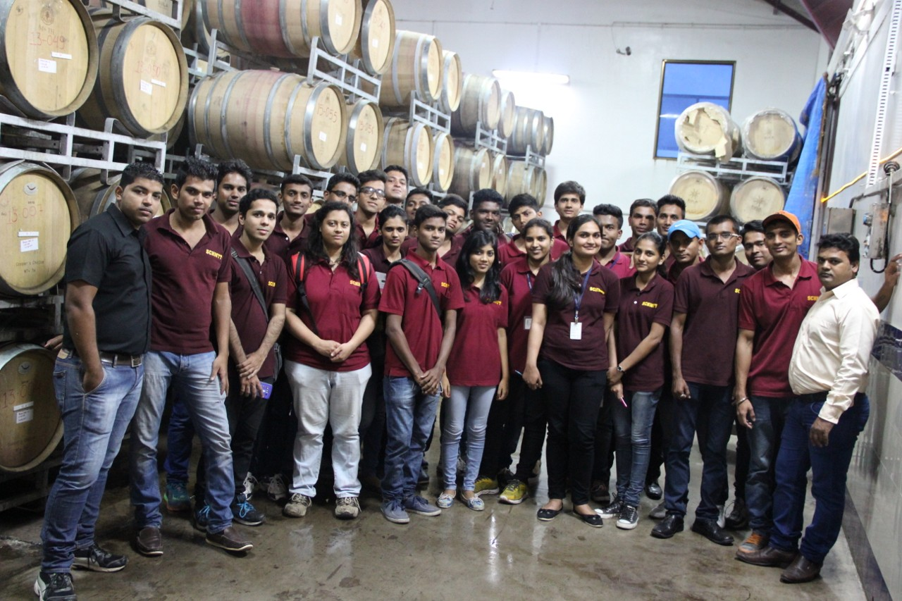 Students and faculty at the wine cellar at Sula Winery Nashik